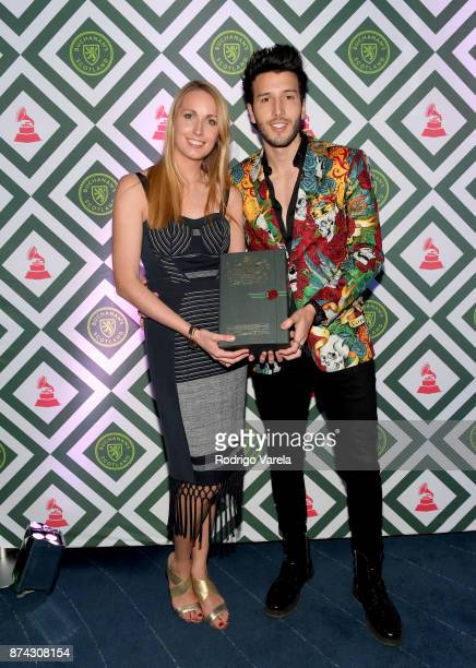 Tara King Brand Manager for Buchanan's and Sebastián Yatra attend Buchanan's New Artist during the 18th annual Latin Grammy Awards at Casa Buchanan's...