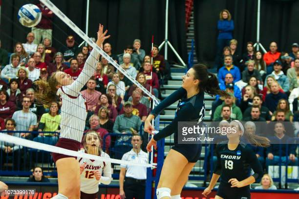 Tara Martin of Emory University spikes the ball past McKenna Covey of Calvin College during the Division III Women's Volleyball Championship held at...