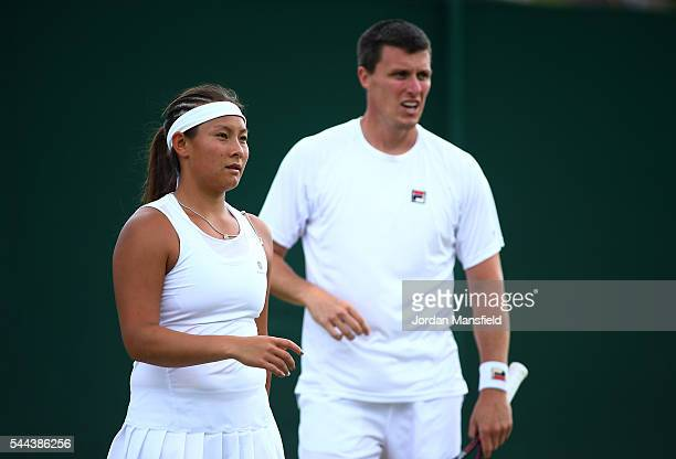 Tara Moore of Great Britain and Ken Skupski of Great Britain in conversation during the Mixed Doubled first round match against Robert Lindstedt of...