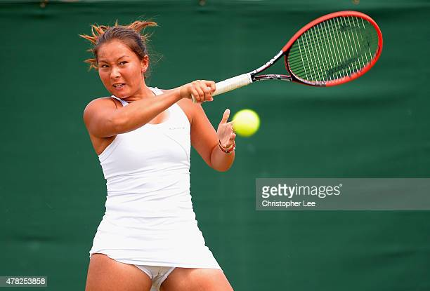 Tara Moore of Great Britain in action against Aliaksandra Sasnovich of Belerus in the Ladies Second Round during the 2015 Wimbledon Qualifying...