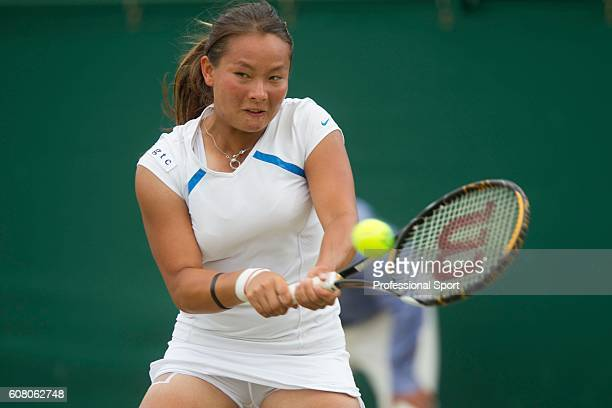 Tara Moore of Great Britain in action during her Girls Singles match against Nigina Abduraimova of Uzbekistan on Day Nine of the Wimbledon Lawn...