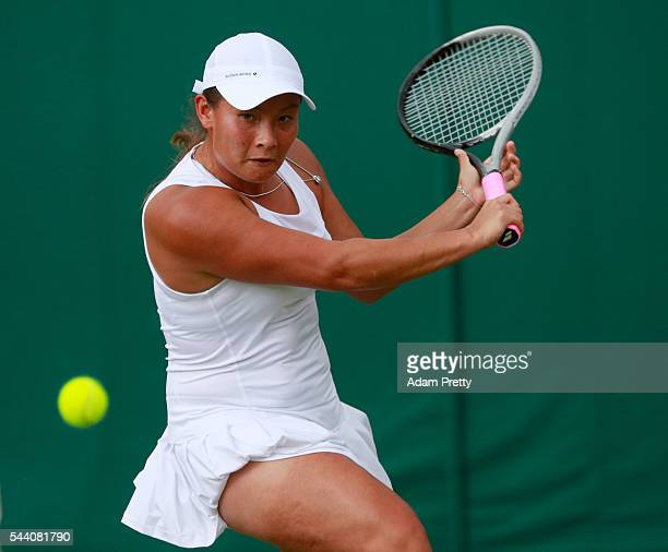 Tara moore of Great Britain plays a backhand during the Ladies Singles second round match against Svetlana Kuznetsova of Russia on day five of the...