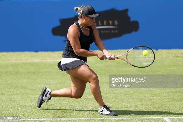 Tara Moore of Great Britain plays a backhand in her women's singles match against Naomi Broady of Great Britain during the Aegon Surbiton Trophy at...