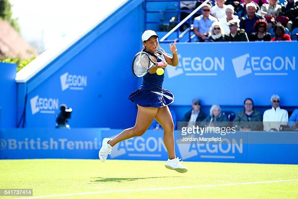 Tara Moore of Great Britain plays a forehand during her first round match against Ekaterina Makarova of Russia during day one of the Aegon...
