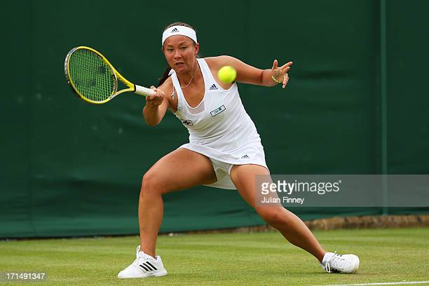 Tara Moore of Great Britain plays a forehand during her Ladies' Singles first round match against Kaia Kanepi of Estonia on day two of the Wimbledon...