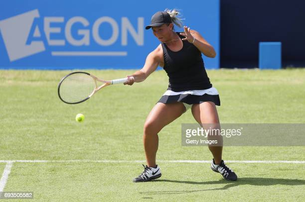 Tara Moore of Great Britain plays a forehand in her women's singles match against Naomi Broady of Great Britain during the Aegon Surbiton Trophy at...