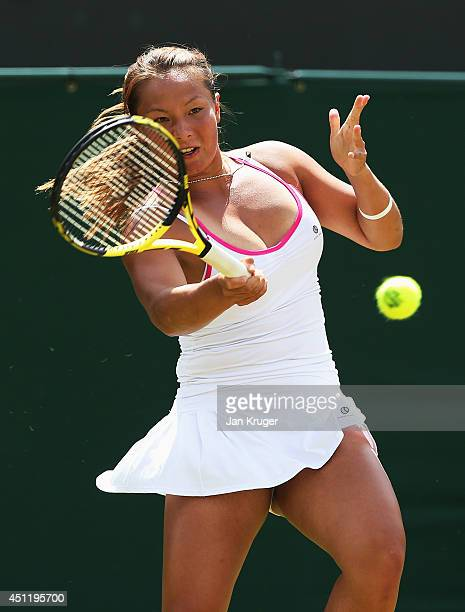 Tara Moore of Great Britain plays a forehand shot during her Ladies' Singles first round match against Vera Zvonareva of Russia on day three of the...
