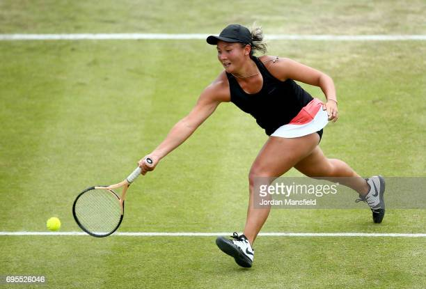 Tara Moore of Great Britain reaches for a forehand during her Women's first round singles match against Johanna Konta of Great Britain on day two of...