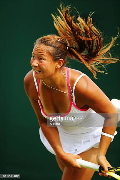 Tara Moore of Great Britain serves during her Ladies Doubles first round match with Johanna Konta against Daniela Hantuchova of Slovakia and Mirjana...