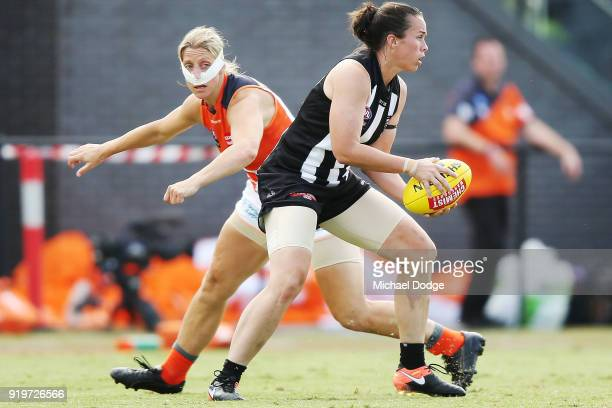 Tara Morgan of the Magpies runs with the ball past Cora Staunton of GWS during the round three AFLW match between the Collingwood Magpies and the...