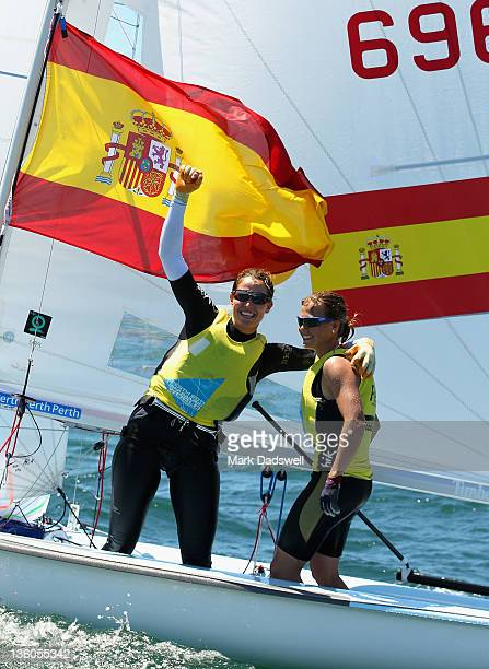 Tara Pacheco and Berta Betanzos of Spain celebrate their win in the 470 Women's Two Person Dinghy medal race on the Centre Course during day 16 of...