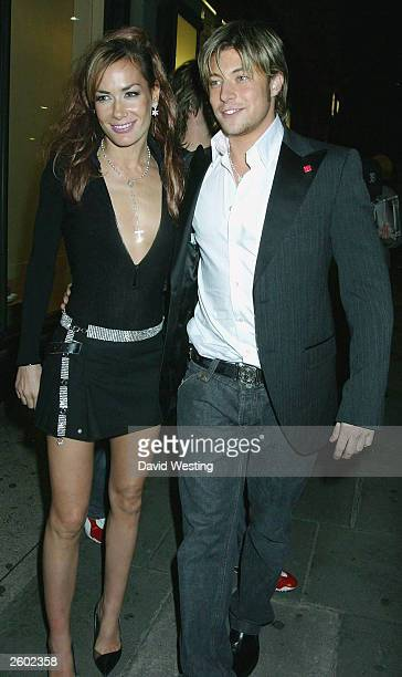 Tara PalmerTomkinson and Duncan James from boyband Blue arrive at the party for 'Fashion Rocks' at the Kensington Roof Gardens on October 15 2003 in...