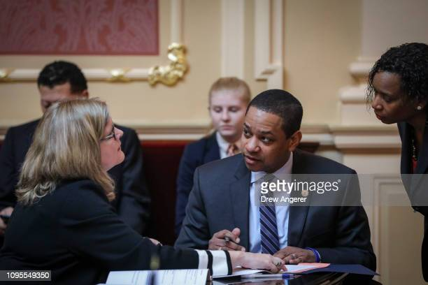 Tara Perkinson chief deputy clerk of the Virginia State Senate speaks with Virginia Lt Governor Justin Fairfax on the Senate floor at the Virginia...