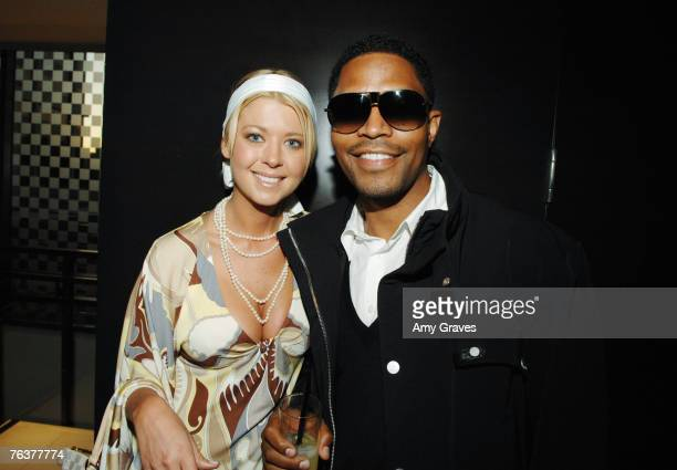 Tara Reid and Ed Blue attend the Louis Vuitton & Details Sunset on the Rooftop Party.