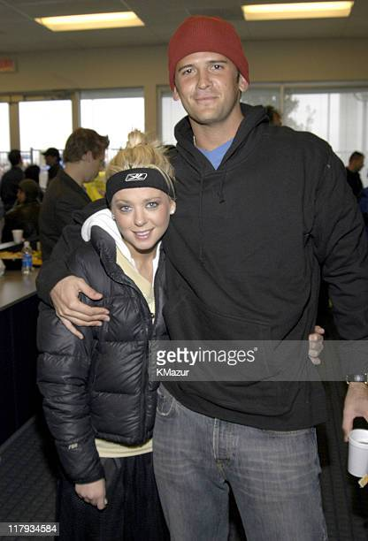Tara Reid and guest during MTV's Rock N Jock Super Bowl XXXVIII at MTV Compound Near Reliant Stadium in Houston Texas United States