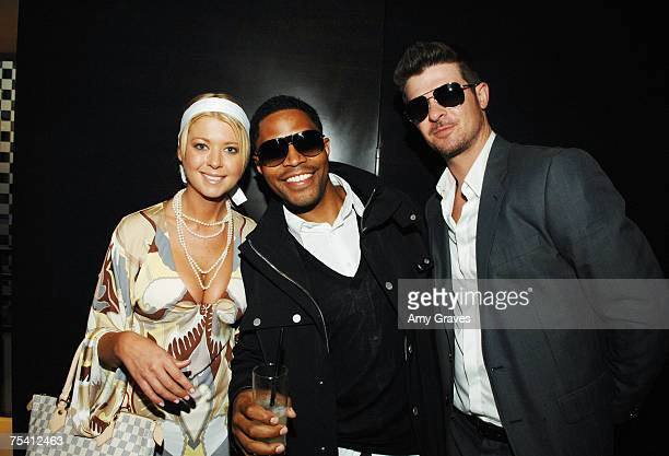 Tara Reid Ed Blue and Robin Thicke attend the Louis Vuitton Details Sunset on the Rooftop Party on July 122007 in Beverly Hills California