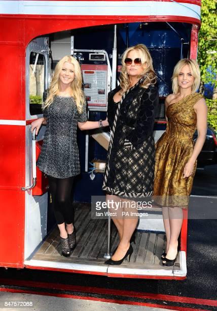 Tara Reid Jennifer Coolidge and Mena Suvari on an open top bus in London to promote their new film American PieReunion