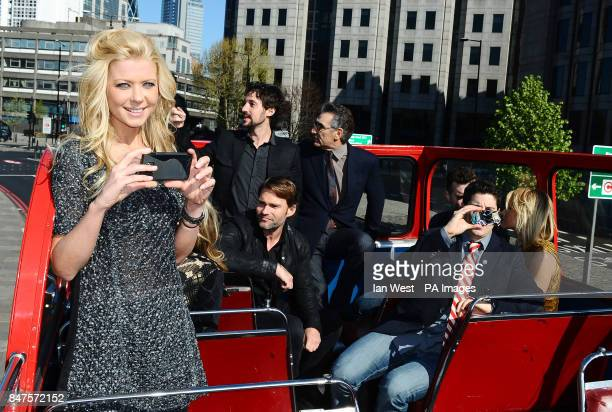 Tara Reid takes photos of the cast while on an open top bus to promote their new film American PieReunion in London
