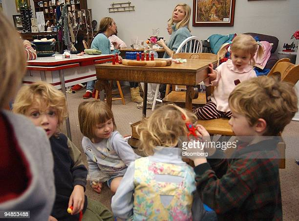 Tara Trent rear looks at the children belonging to her and her friends during a lunch date at a coffee shop in Lake Geneva Wisconsin Wednesday...