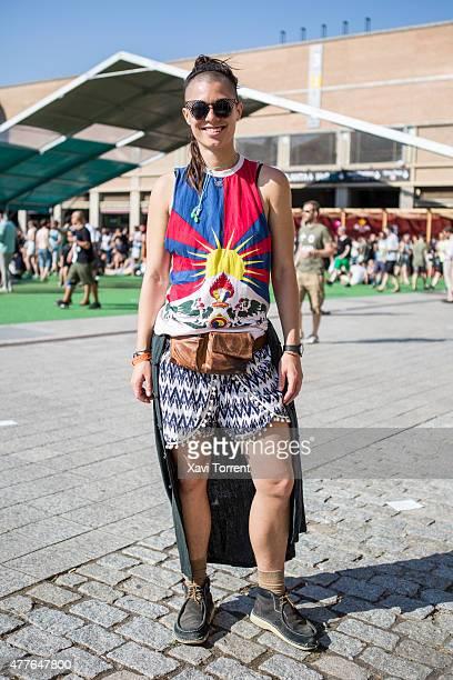 Tara wears tibetan flag T-Shirt , Yumundi markets Sunshine Coast shorts and Birkenstock shoes during day 1 of Sonar Music Festival on June 18, 2015...
