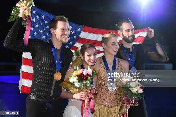 Tarah Kayne and Danny O'Shea Ashley Cain and Timothy Leduc of the USA pose with their medals for the pairs free skating during day three of the Four...
