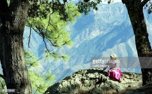 Tarahumara woman resting on a rock, overlooking Urique Canyon, Mexico, 1998.