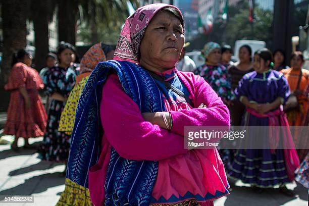 Tarahumara woman wearing her traditional clothing, protest during a commemoration of International Women's Day at Palacio de Bellas Artes on March...
