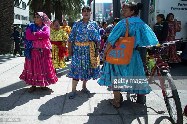Tarahumara women wearing their traditional clothing, protest during a commemoration of International Women's Day at Palacio de Bellas Artes on March...