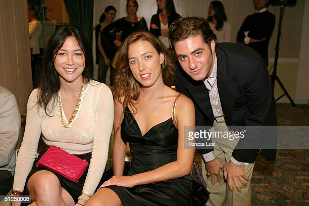 Tarajia Morrell Andrea Tese and Andrew Black pose for a picture at the Matthew Earnest Spring 2005 fashion show during the Olympus Fashion Week...