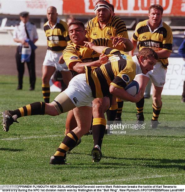 Taranaki centre Mark Robinson breaks the tackle of Karl Tenana to rscore a try during the NPC 1st division match won by Wellington at the 'Bull Ring'...