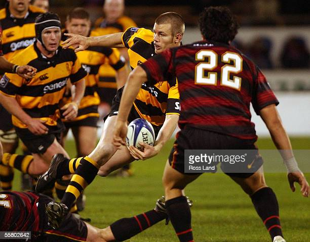 Taranaki replacement Mark Stewart passes the ball as Neil Crowley looks on during their sides 2732 loss to Canterbury in the Ranfurly Shield NPC...