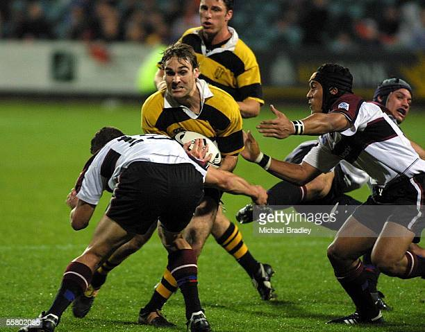 Taranaki's Dominic Byrne is tacken in a solid tackle by North Harbours defence during the rugby NPC game between North Harbour and Taranaki played at...