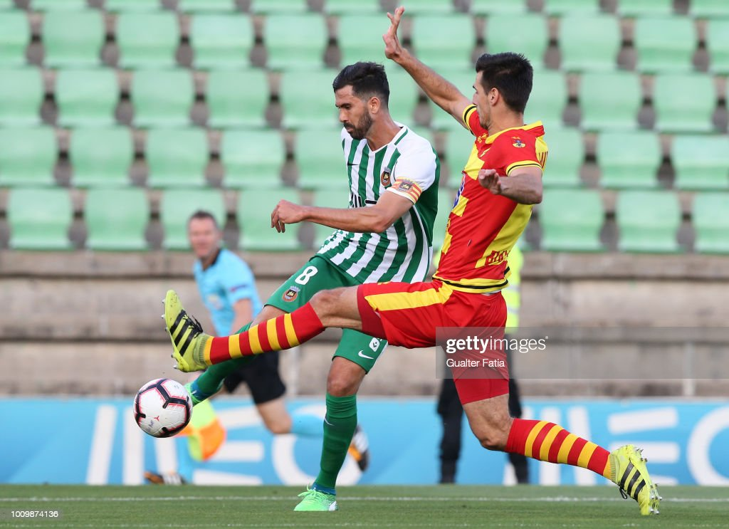 Tarantini of Rio Ave FC competes for the ball with Nemanja Mitrovic of Jagiellonia during the UEFA Europa League Second Qualifying Round 2nd Leg match between Rio Ave FC and Jagiellonia at Estadio dos Arcos on August 2, 2018 in Vila do Conde, Portugal.