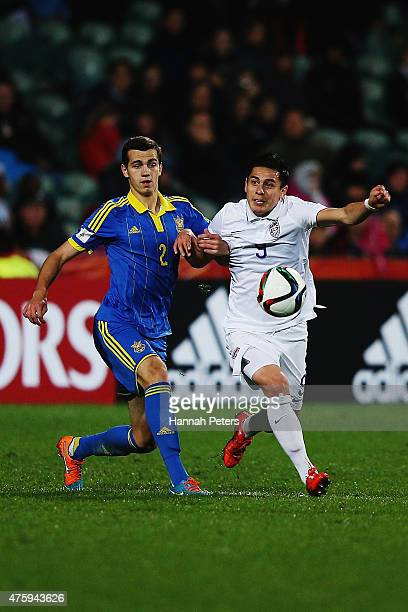 Taras Kacharaba of Ukraine competes with Rubio Rubin of USA during the FIFA U20 World Cup New Zealand 2015 Pool A match between Ukraine and the...