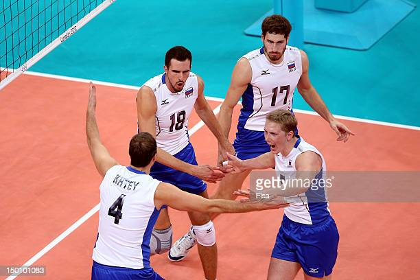 Taras Khtey of Russia celebrates with his teammates Alexander Volkov Sergey Grankin and Maxim Mikhaylov after a point against Bulgaria during the...