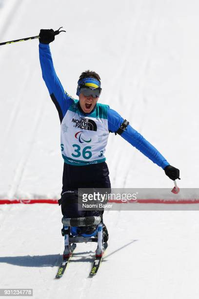 Taras Rad of Ukraine celebrates victory in the Men's Biathlon 125km Sitting on day four of the PyeongChang 2018 Paralympic Games on March 13 2018 in...