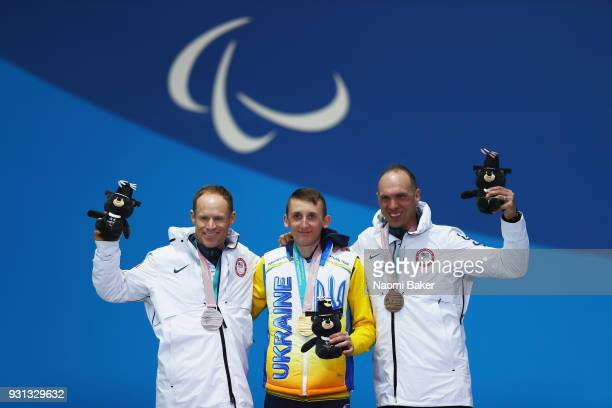 Taras Rad of Ukraine Silver medallist Daniel Cnossen of USA and Bronze medallist Andrew Soule of USA pose during the medal ceremony for the Men's...