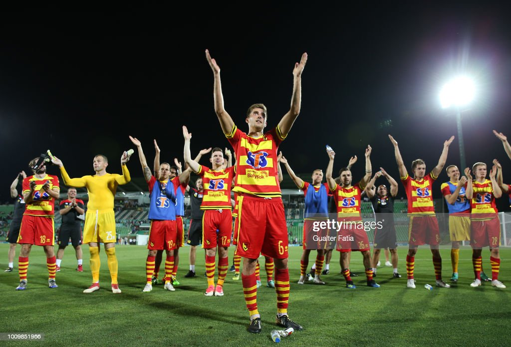 Taras Romanczuk of Jagiellonia and teammates celebrate with supporters at the end of the UEFA Europa League Second Qualifying Round 2nd Leg match between Rio Ave FC and Jagiellonia at Estadio dos Arcos on August 2, 2018 in Vila do Conde, Portugal.