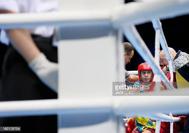 Taras Shelestyuk of the Ukraine receives corner instructions between rounds against Freddie Evans of Great Britain during the men's Welterweight...