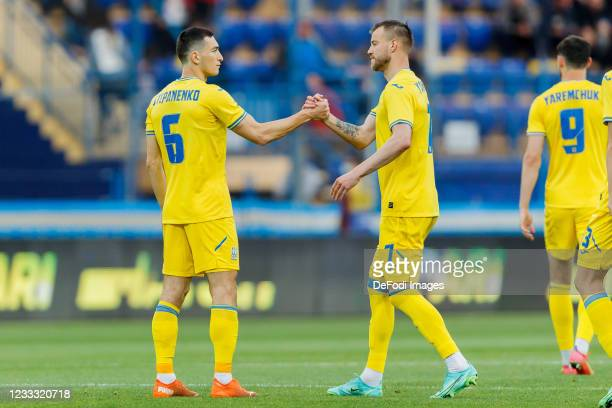Taras Stepanenko of Ukraine and Andriy Yarmolenko of Ukraine look on during the international friendly match between Ukraine and Cyprus at Metalist...