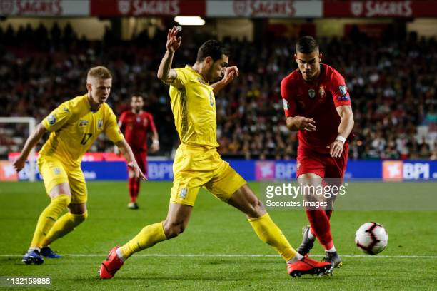 Taras Stepanenko of Ukraine Andre Silva of Portugal during the EURO Qualifier match between Portugal v Ukraine at the Estádio da Luz on March 22 2019...