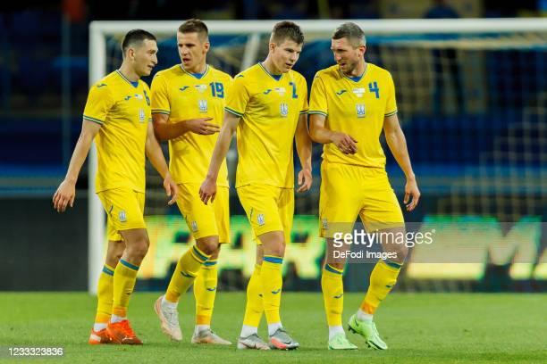 Taras Stepanenko of Ukraine, Denys Popov of Ukraine, Eduard Sobol of Ukraine and Sergiy Kryvtsov of Ukraine look on after the international friendly...