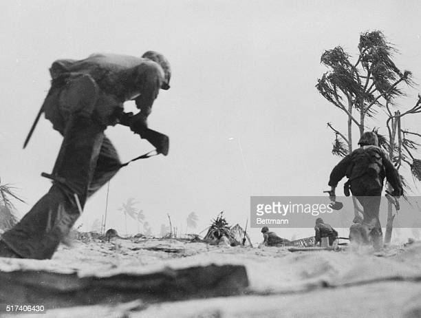 Tarawa Gilbert IslandsGoing In With Cold Steel At Tarawa U S Marines charge across open ground from the beach at Tarawa to the airport which was the...