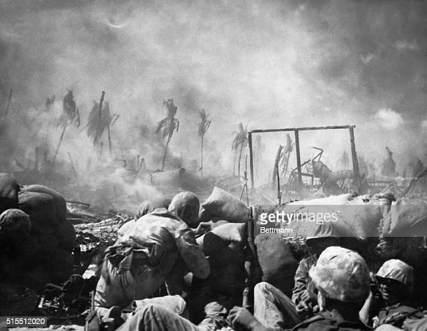 Tarawa US Marines are seen firing from behind a sand bag entrenchment which they threw up as protection on the flat island of Tarawa where the...