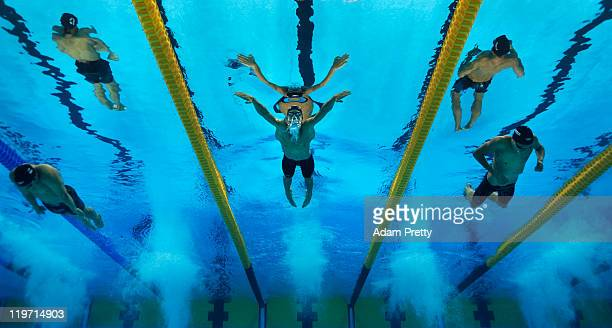 Tarco Liobet of Bolivia, Jordy Groters of Aruba and Benjamin Schulte of Guam compete in the second preliminary heat of the Men's 100m Breaststroke...