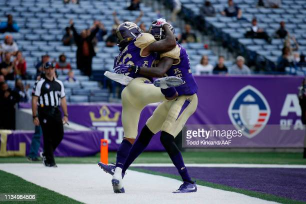 Tarean Folston of Atlanta Legends is congratulated by his teammate Seantavius Jones after scoring a touchdown reception against the Memphis...