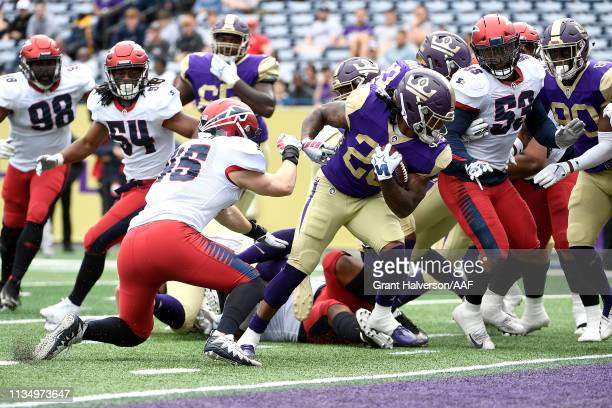 Tarean Folston of Atlanta Legends scores a first half rushing touchdown against the Memphis Express in the Alliance of American Football game at...