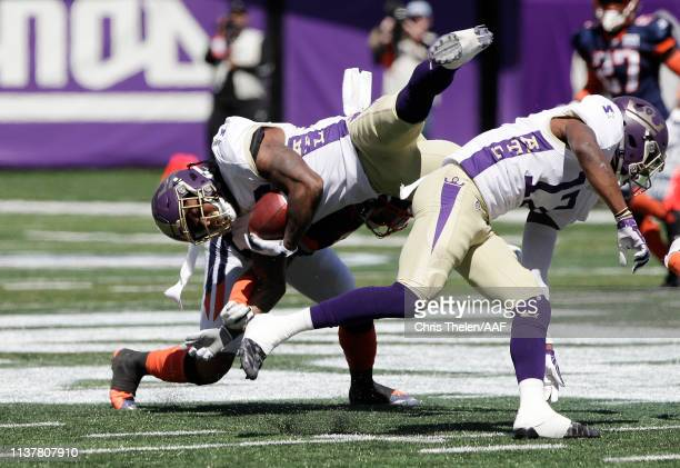 Tarean Folston of the Atlanta Legends is tackled by Josh Evans of the Orlando Apollos during the first half in an Alliance of American Football game...
