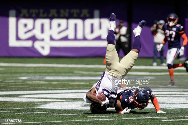 Tarean Folston of the Atlanta Legends is upended as he is tackled by Josh Evans of the Orlando Apollos during the first half in an Alliance of...