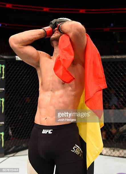 Tarec Saffiedine celebrates his victory over Jake Ellenberger in their welterweight bout during the UFC Fight Night event at the Prudential Center on...